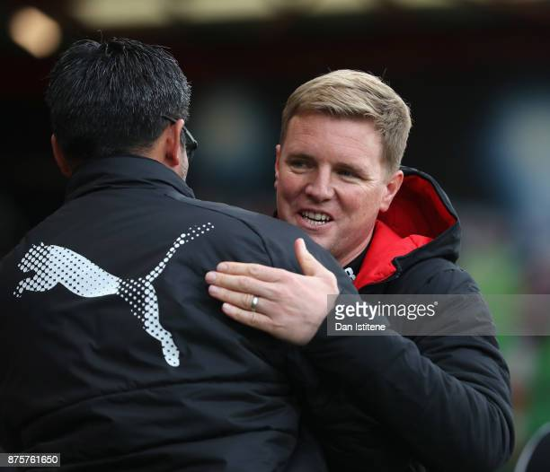 Eddie Howe Manager of AFC Bournemouth and David Wagner Manager of Huddersfield Town greet prior to the Premier League match between AFC Bournemouth...