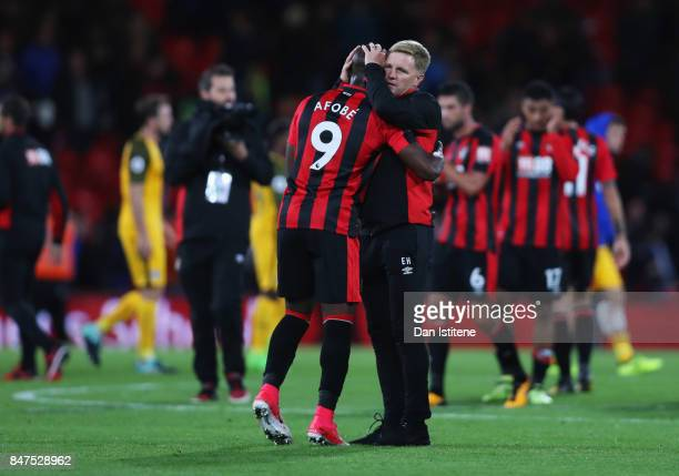 Eddie Howe Manager of AFC Bournemouth celebrates victory with Benik Afobe of AFC Bournemouth after the Premier League match between AFC Bournemouth...