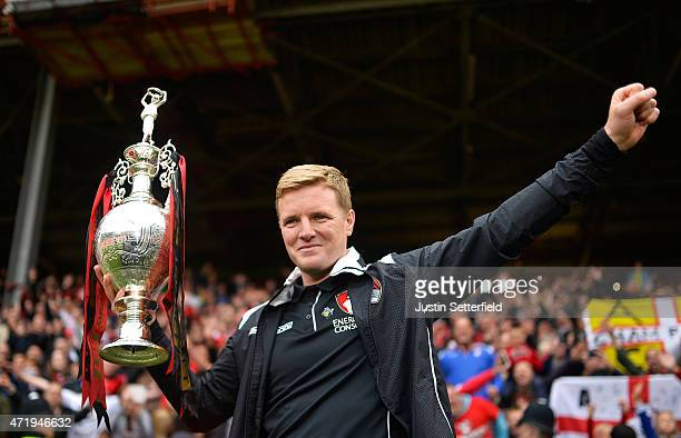 Eddie Howe Manager of AFC Bournemouth lifts the Championship trophy after winning the the Sky Bet Championship after the game between Charlton...
