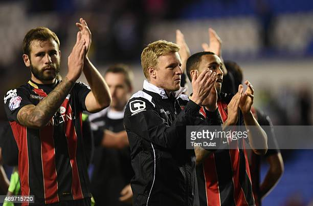 Eddie Howe manager of Bournemouth and players applaud the travelling fans after victory in the Sky Bet Championship match between Reading and AFC...