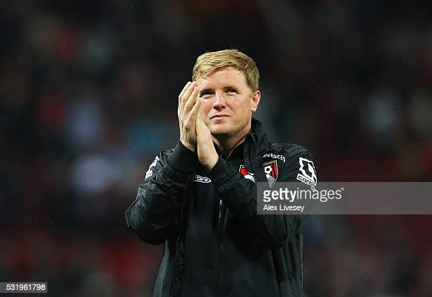 Eddie Howe manager of Bournemouth applauds the travelling fans after the Barclays Premier League match between Manchester United and AFC Bournemouth...