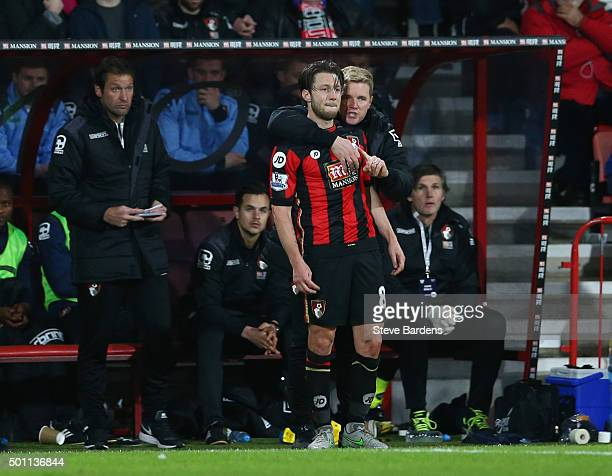 Eddie Howe Manager of Bournemouth embraces Harry Arter as they stand in the technical area during the Barclays Premier League match between AFC...