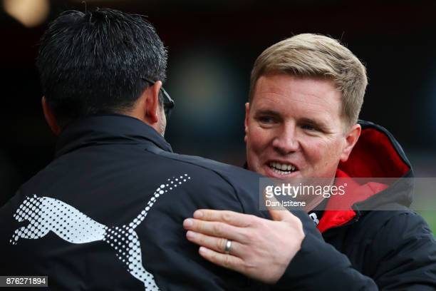 Eddie Howe manager of Bournemouth greets David Wagner manager of Huddersfield Town before the Premier League match between AFC Bournemouth and...