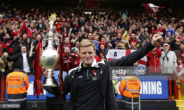 Eddie Howe manager of Bournemouth poses with the trophy after winning the Championship during the Sky Bet Championship match between Charlton...