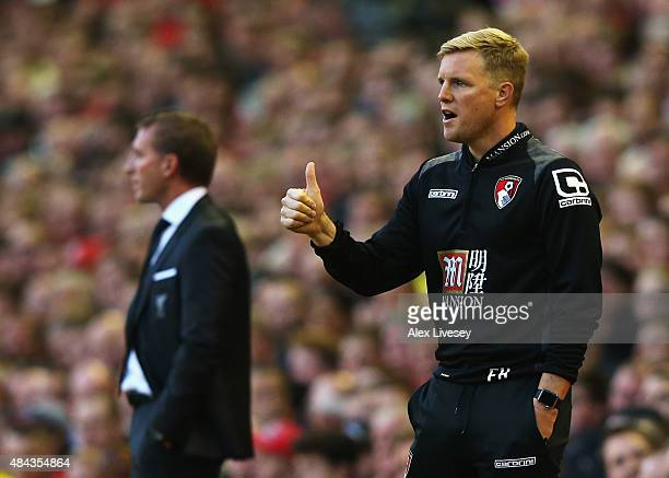 Eddie Howe manager of Bournemouth signals as Brendan Rodgers manager of Liverpool looks on during the Barclays Premier League match between Liverpool...