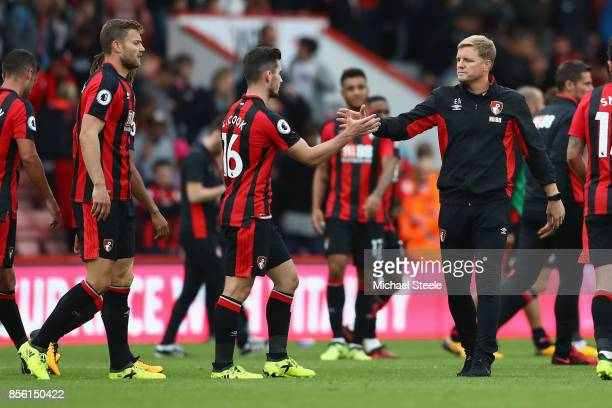 Eddie Howe the manager of Bournemouth shakes hands with Lewis Cook after his side's 00 draw during the Premier League match between AFC Bournemouth...