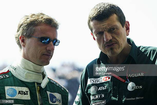 Eddie Irvine of Northern Ireland and Jaguar chats to Guenther Steiner during first practice for the Formula One French Grand Prix at Nevers...