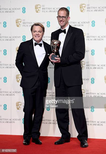 Eddie Izzard and Pete Docter winner of the Best Animated Film Award for 'Inside Out' pose in the winners room at the EE British Academy Film Awards...
