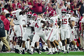 Eddie Jackson of the Alabama Crimson Tide celebrates with his teammates after intercepting a ball in the second quarter thrown by Deshaun Watson of...