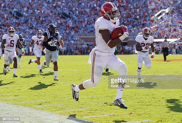 Eddie Jackson of the Alabama Crimson Tide returns a punt for a touchdown against the Mississippi Rebels at VaughtHemingway Stadium on September 17...