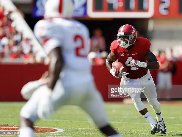 Eddie Jackson of the Alabama Crimson Tide returns an interception on the way to a touchdown against the Western Kentucky Hilltoppers at BryantDenny...