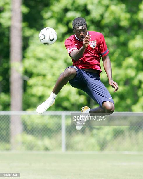 Eddie Johnson leaps high for a header In the final training session at the camp at SAS Park in Cary North Carolina on May 21 2006
