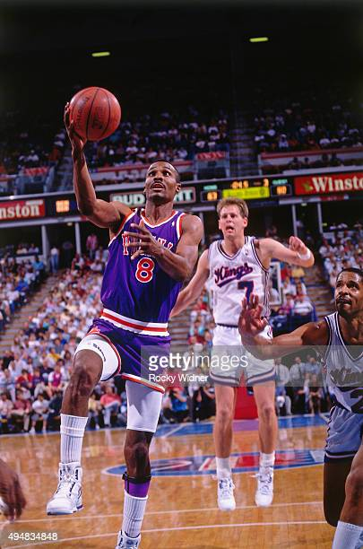 Eddie Johnson of the Phoenix Suns shoots against the Sacramento Kings circa 1990 at Arco Arena in Sacramento California NOTE TO USER User expressly...