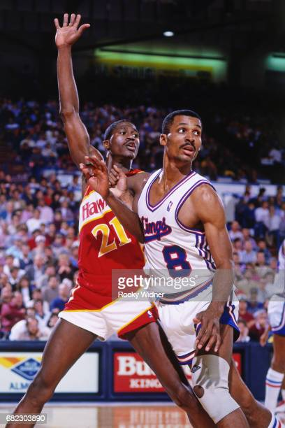 Eddie Johnson of the Sacramento Kings defends against Dominique Wilkins of the Atlanta Hawks during a game played circa 1988 at Arco Arena in...