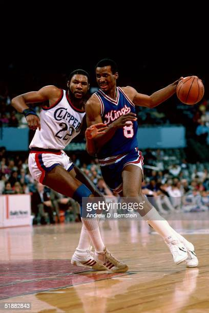 Eddie Johnson of the Sacramento Kings drives to the basket against the Los Angeles Clippers circa 1984 during an NBA game in Los Angeles California...