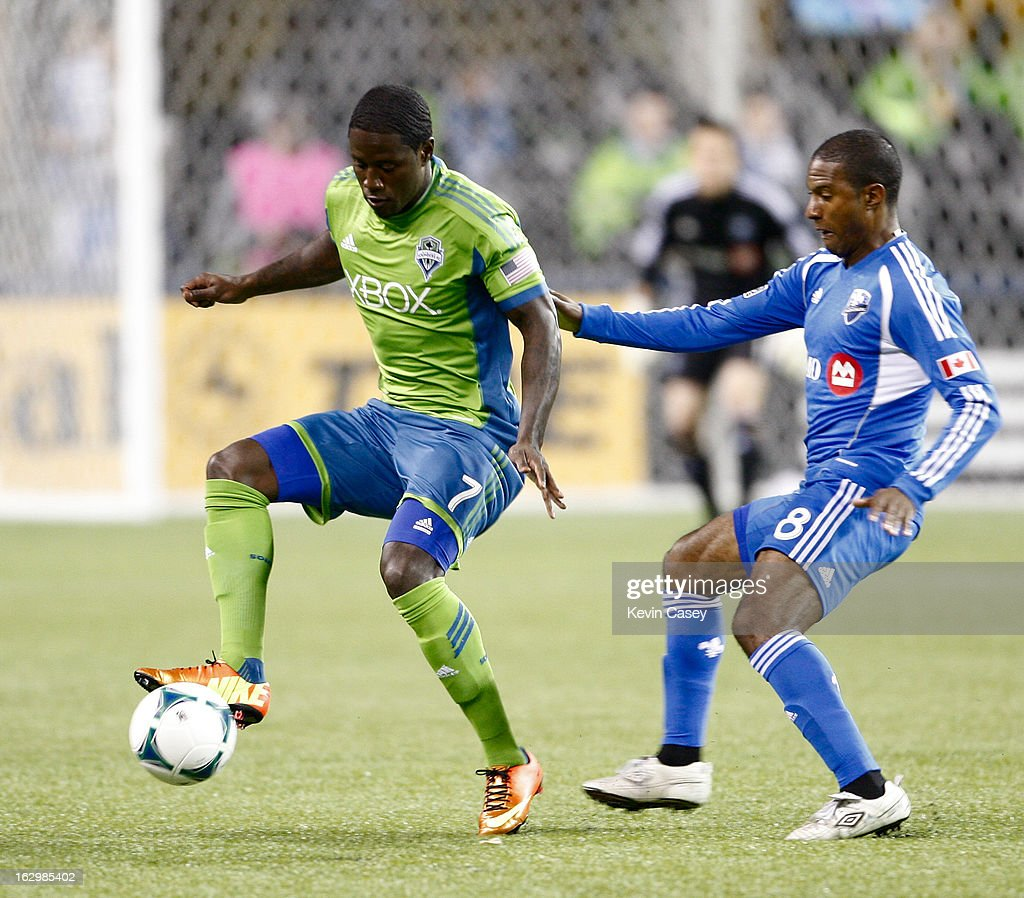Eddie Johnson #7 of the Seattle Sounders controls the ball in front of Patrice Bernier #8 of Montreal Impact in the first half at CenturyLink Field on March 2, 2013 in Seattle, Washington.