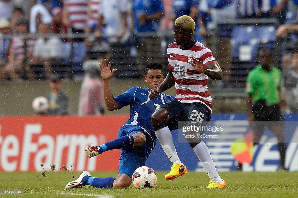 Eddie Johnson #26 of the United States battles for the ball against Darwin Ceren Delgado #7 of El Salvador in the second half during the 2013 CONCACAF Gold Cup quarterfinal game at M&T Bank Stadium on July 21, 2013 in Baltimore, Maryland.