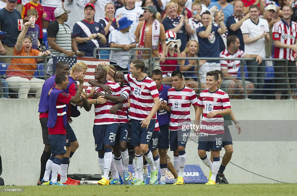 Eddie Johnson (4th L) of the US celebrates with his team after scoring a goal in the second half of the CONCACAF Gold Cup quarterfinal match in Baltimore on July 21, 2013. AFP PHOTO/JIM WATSON