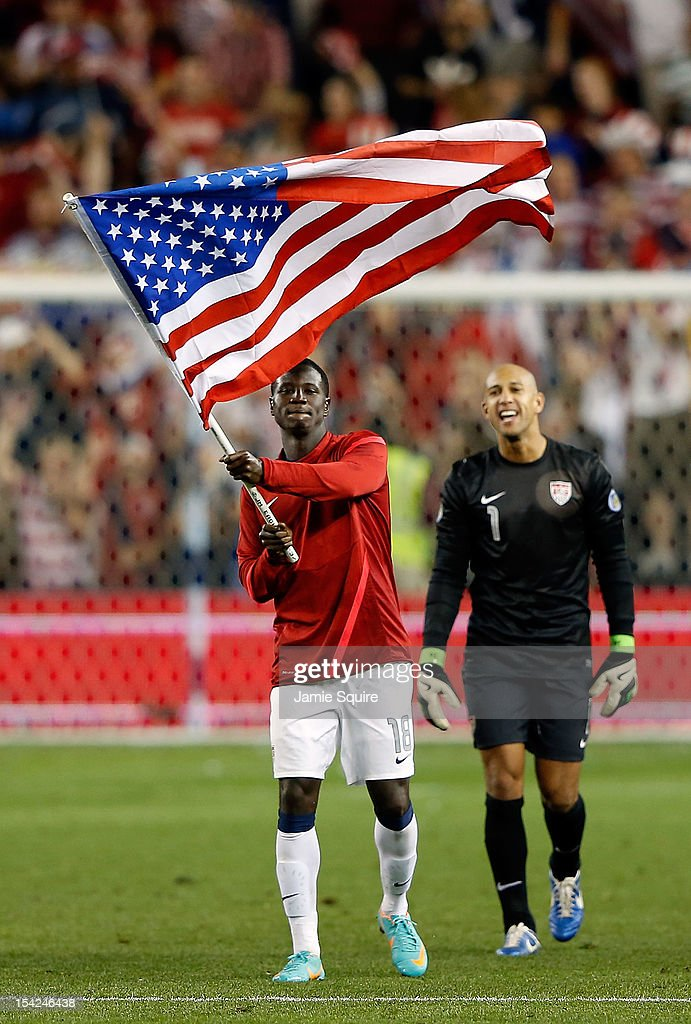 Eddie Johnson #18 of the USA waves an American flag as goalkeeper <a gi-track='captionPersonalityLinkClicked' href=/galleries/search?phrase=Tim+Howard+-+Soccer+Player&family=editorial&specificpeople=11515558 ng-click='$event.stopPropagation()'>Tim Howard</a> #1 looks on after the USA defeated Guatemala 3-1 to win the World Cup Qualifying match at LiveStrong Sporting Park on October 16, 2012 in Kansas City, Kansas.