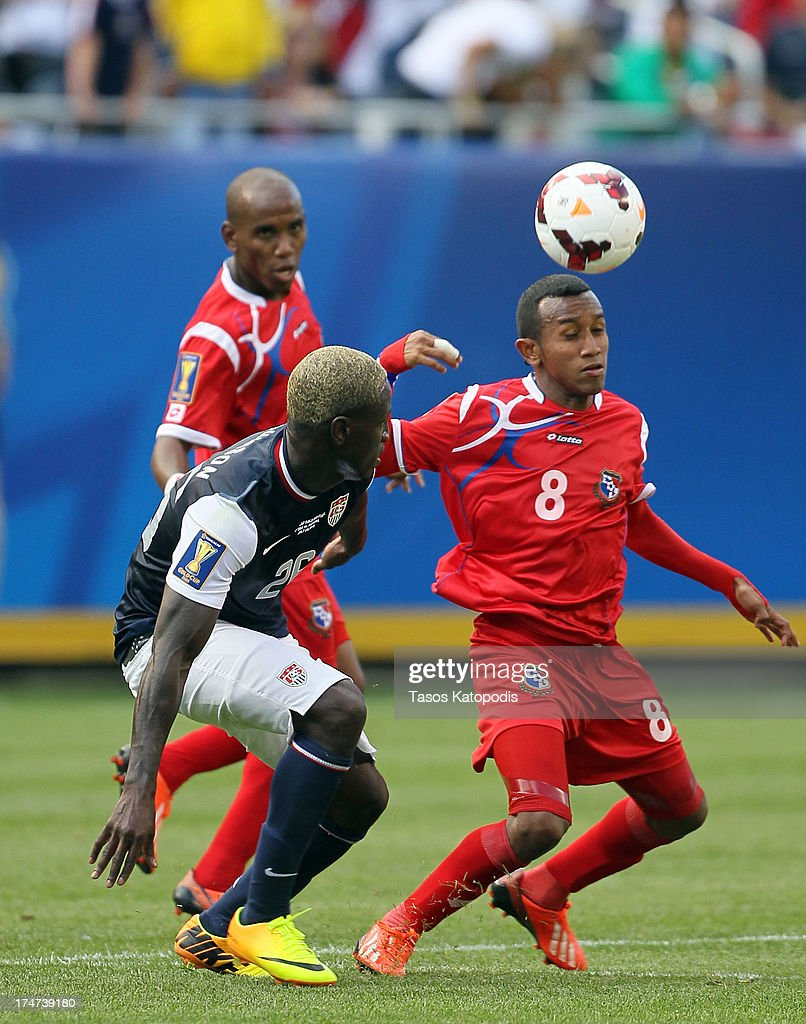 Eddie Johnson #26 of USA fights for the ball with Marcos Sanchez #8 of Panama in the second half at the 2013 CONCACAF Gold Cup Final at Soldier Field July 28, 2013 in Chicago, Illinois.