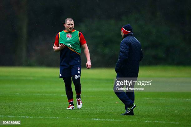 Eddie Jones England Head Coach speaks with Dylan Hartley the newly appointed Captain during a training session at Pennyhill Park on January 26 2016...