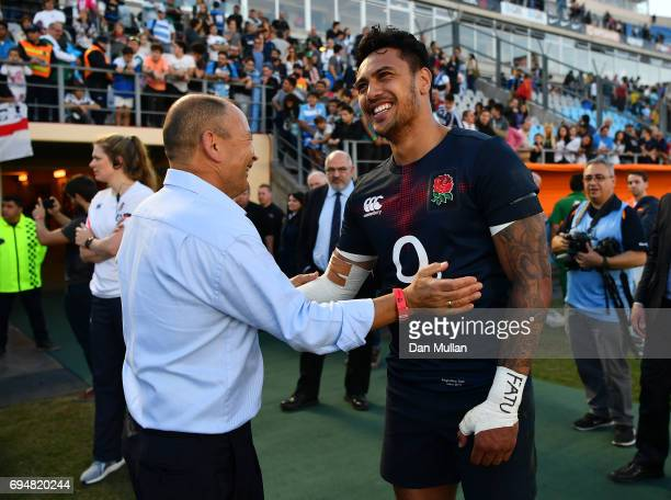 Eddie Jones Head Coach of England congratulates Denny Solomona of England following the ICBC Cup match between Argentina and England at the Estadio...
