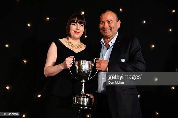 Eddie Jones Head Coach of England is presented with the Rugby Union Writers' Club Pat Marshall Award by Sarah Mockford during the Rugby Union...