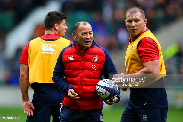 Eddie Jones Head Coach of England speaks with Dylan Hartley captain of England during an England Rugby open training session at Twickenham Stadium on...