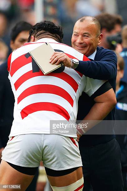 Eddie Jones Head Coach of Japan celebrates with Hiroshi Yamashita of Japan after the 2015 Rugby World Cup Pool B match between Samoa and Japan at...