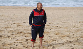 Eddie Jones the England head coach looks on during the England recovery session held at Coogee Beach on June 20 2016 in Sydney Australia