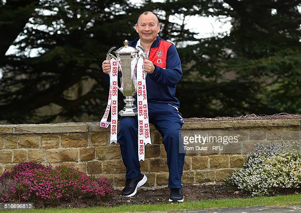 Eddie Jones the England head coach poses with the RBS 6 Nations Trophy during the England media session held at Pennyhill Park on March 20 2016 in...