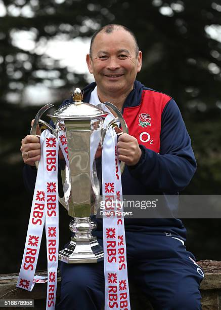Eddie Jones the England head coach poses with the Six Nations trophy after their Grand Slam victory against France at Pennyhill Park on March 20 2016...