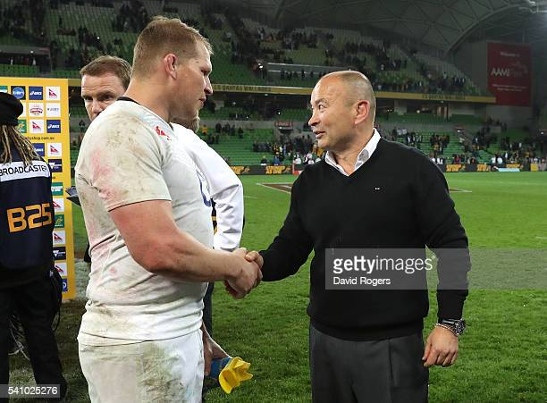 Eddie Jones the England head coach shakes hands with team captain Dylan Hartley after their victory during the International Test match between the...