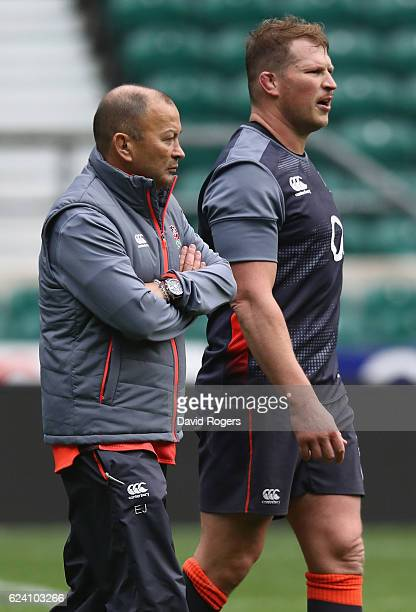Eddie Jones the England head coach talks to team captain Dylan Hartley during the England captain's run at Twickenham Stadium on November 18 2016 in...