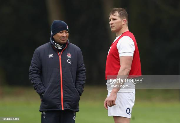 Eddie Jones the England head coach talks to team captain Dylan Hartley during the England training session held at Pennyhill Park on February 9 2017...