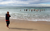 Eddie Jones the England head coach walks down the beach as his players take a swm in the ocean during the England recovery session held at Coogee...