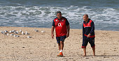 Eddie Jones the England head coach walks on the beach with skills coach Glen Ella during the England recovery session held at Coogee Beach on June 20...