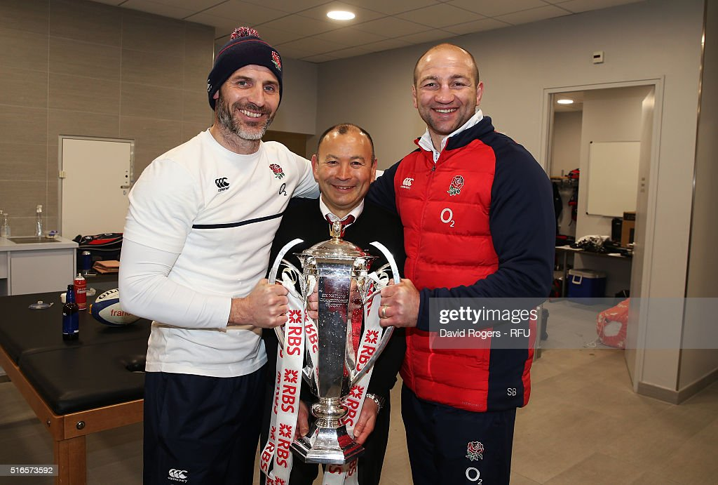 Eddie Jones the head coach of England and his assistant coaches, Paul Gustard (L) and Steve Borthwick (R) celebrate with the trophy following their team's 31-21 victory during the RBS Six Nations match between France and England at the Stade de France on March 19, 2016 in Paris, France.