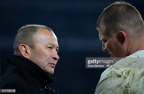 Eddie Jones the head coach of England speaks with Dylan Hartley of England following the final whistle during the RBS Six Nations match between...