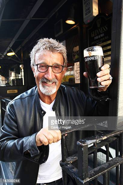 Eddie Jordan poses for a photocall to celebrate receiving an OBE at The Toucan Bar on March 28 2012 in London England