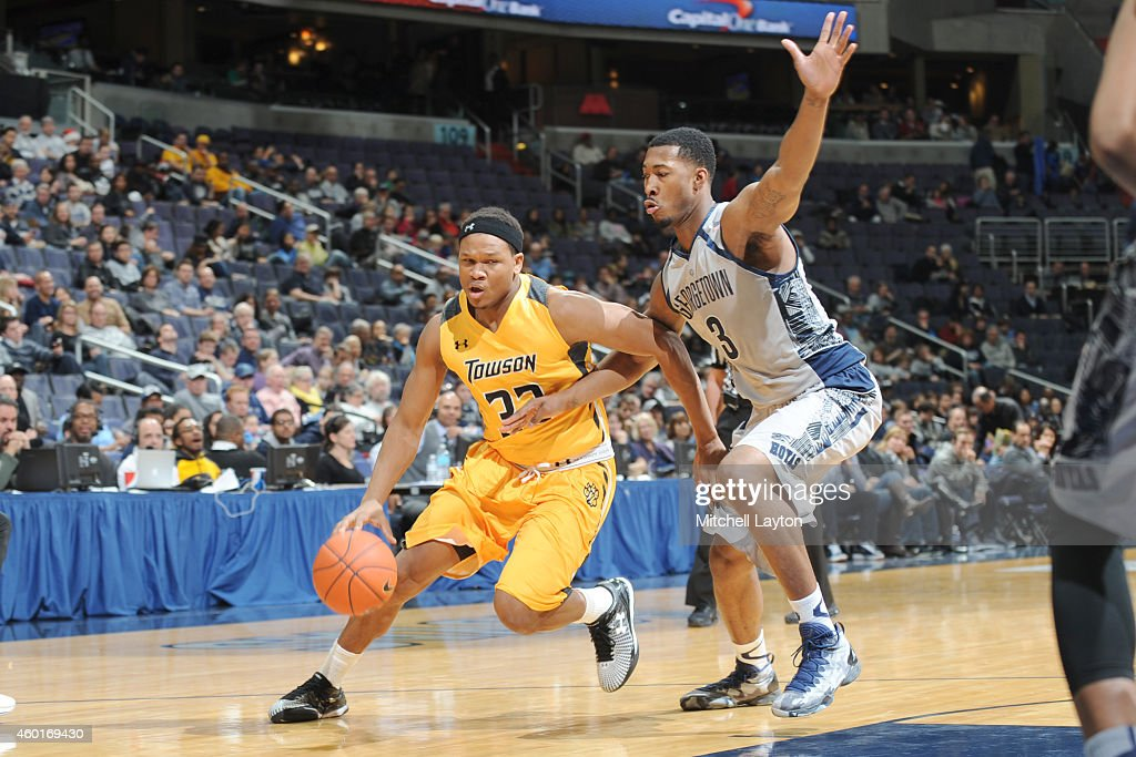 Eddie Keith #33 of the Towson Tigers dribbles up <a gi-track='captionPersonalityLinkClicked' href=/galleries/search?phrase=Mikael+Hopkins&family=editorial&specificpeople=6753587 ng-click='$event.stopPropagation()'>Mikael Hopkins</a> #3 of the Georgetown Hoyas during game two of the BB&T Classic college basketball game at the Verizon Center on December 7, 2014 in Washington, DC. The Hoyas won 78-46.