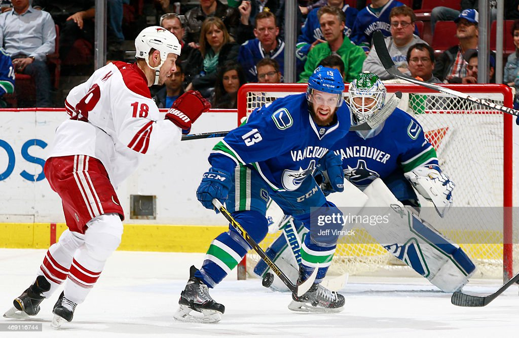Eddie Lack #31 and <a gi-track='captionPersonalityLinkClicked' href=/galleries/search?phrase=Nick+Bonino&family=editorial&specificpeople=5805660 ng-click='$event.stopPropagation()'>Nick Bonino</a> #13 of the Vancouver Canucks defend against <a gi-track='captionPersonalityLinkClicked' href=/galleries/search?phrase=David+Moss+-+Ice+Hockey+Player&family=editorial&specificpeople=6928499 ng-click='$event.stopPropagation()'>David Moss</a> #18 of the Phoenix Coyotes during their NHL game at Rogers Arena April 9, 2015 in Vancouver, British Columbia, Canada.