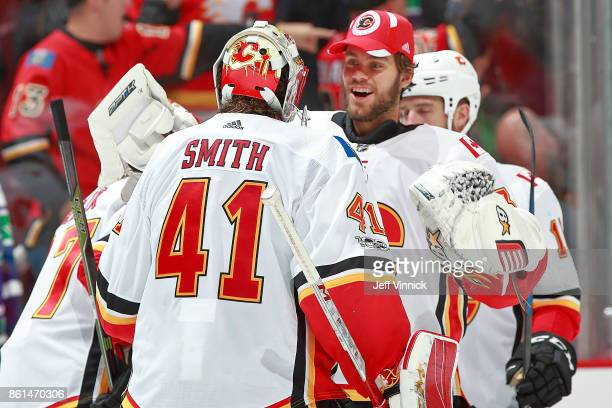 Eddie Lack of the Calgary Flames congratulates teammate Mike Smith after their NHL game against the Vancouver Canucks at Rogers Arena October 14 2017...