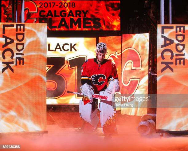 Eddie Lack of the Calgary Flames in action against the Winnipeg Jets during an NHL game at Scotiabank Saddledome on October 7 2017 in Calgary Alberta...
