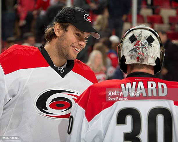 Eddie Lack of the Carolina Hurricanes congratulates teammate Cam Ward of the Carolina Hurricanes after defeating the Detroit Red Wings 53 during an...