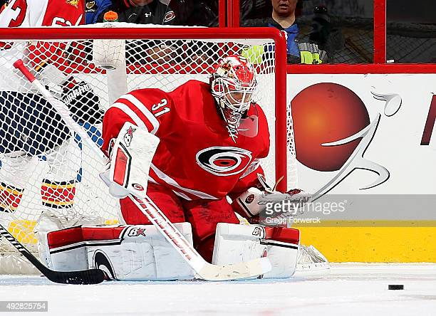 Eddie Lack of the Carolina Hurricanes goes down in the crease to stop a puck during a NHL game against the Florida Panthers at PNC Arena on October...