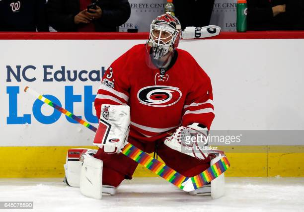 Eddie Lack of the Carolina Hurricanes his stick wrapped in pride tape stretches during warmpus prior to an NHL game against the Ottawa Senators on...
