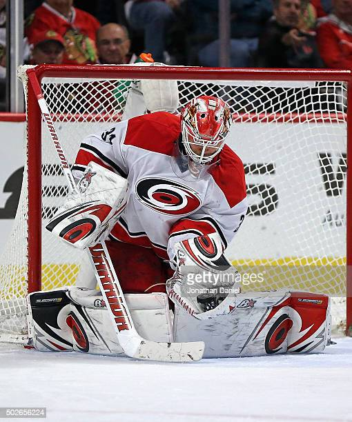 Eddie Lack of the Carolina Hurricanes makes a glove save against the Chicago Blackhawks at the United Center on December 27 2015 in Chicago Illinois...