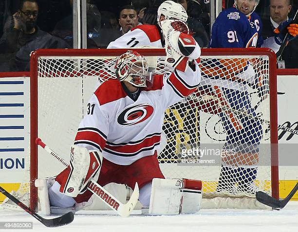 Eddie Lack of the Carolina Hurricanes makes the save against the New York Islanders at the Barclays Center on October 29 2015 in the Brooklyn borough...
