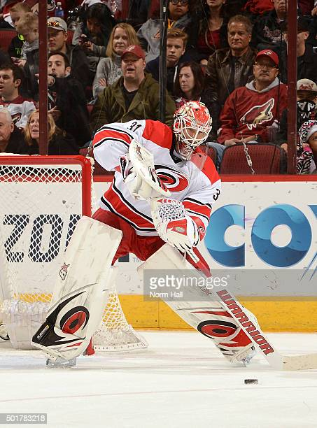 Eddie Lack of the Carolina Hurricanes passes the puck up ice against the Arizona Coyotes at Gila River Arena on December 12 2015 in Glendale Arizona
